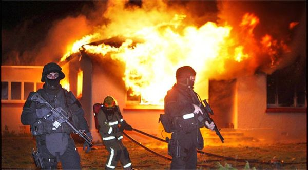 paramilitary police protect firefighters in new zealand